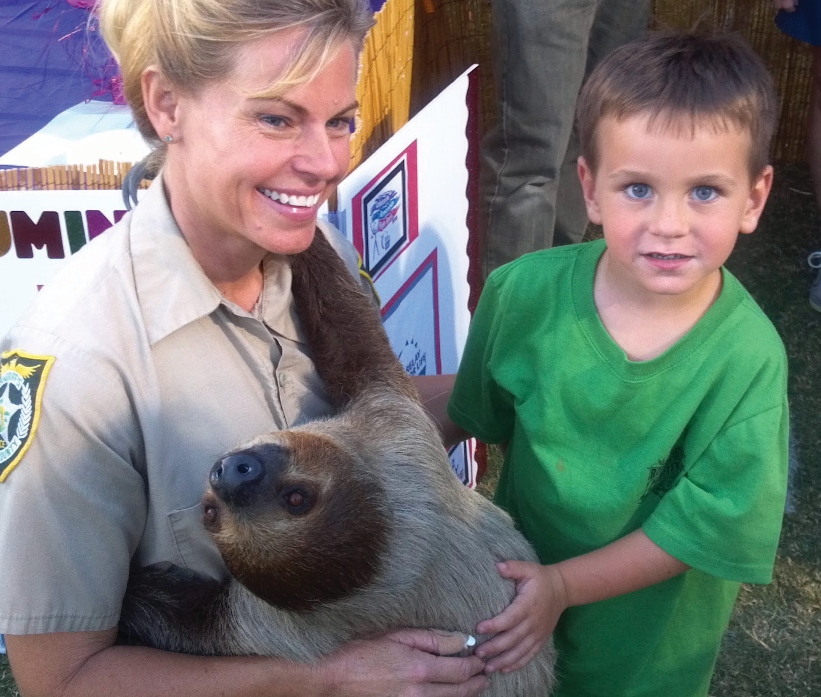 Jeanne Selander shows off a sloth at the Sheriff's farm.