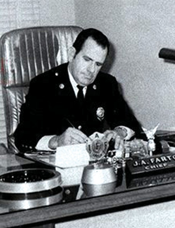 "Fire Chief Joseph ""Bum"" Farto at his desk."
