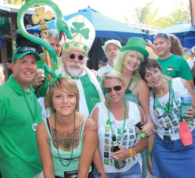 Schooner Wharf co-owner Evalena Worthington with the Schooner Wharf crew, customers and St. Paddy at the annual St. Paddy's Day Bar Stroll.