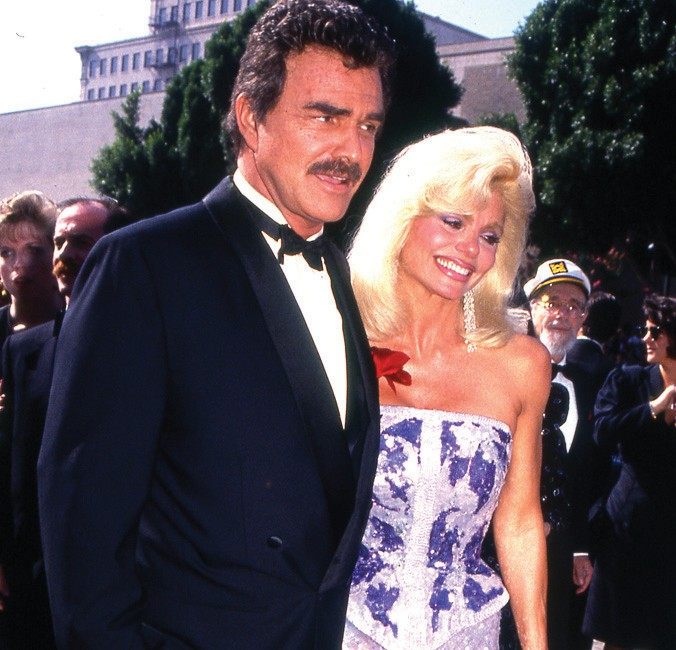 Burt Reynolds and Loni Anderson arriving at a celebrity event in 1991.